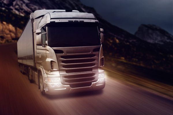 30987722 - gray truck on highway road at night time